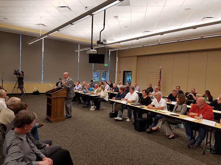 Boone County attorney Bob Clutter addresses the crowd as councilors from across Boone County sit behind him and prepare to open a public hearing. (Photo by Ann Marie Shambaugh)