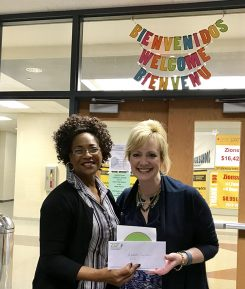 Tracy Phillips, right, presents a grant to Adelpha Twyman, who helped secure a grant for a greenhouse at ZCHS. (Submitted photo)