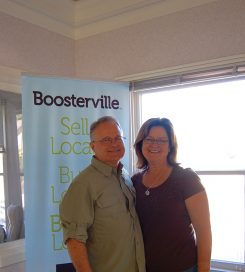 Tom and Pam Cooper, founders of Boosterville. (Photo by Heather Lusk)