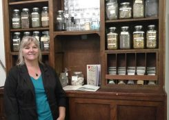 Shanon Marks, owner of Moon Tree Apothecary, found an antique apothecary cabinet to hold her oils, teas and herbs. (Photo by Heather Lusk)