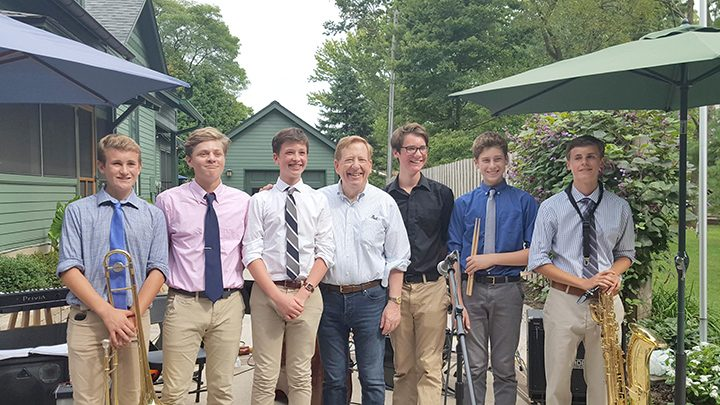 From left, The Low Keys Combo: Oscar Cronin, trombone; Griffin McConnell, tenor saxophone; Andrew Schallwig, keyboard, Carmel Mayor Jim Brainard, Will Rice, bass, Noah Steiner, drums and Sam Grocki, baritone saxophone. (Submitted photo)