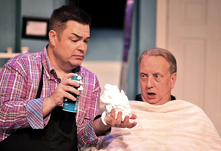 """Nick O'Brien (Jeff Stockberger), right, watches as Tony Whitcomb (Daniel Klingler) fills his hand with shaving cream as he prepares to give Nick a shave in Beef & Boards Dinner Theatre's 2017 season-opener, """"Shear Madness."""" Now on stage through Jan. 29, this madcap murder mystery takes place in a not-so-typical Indianapolis hair salon – and the audience decides how it ends. (Submitted photo)"""