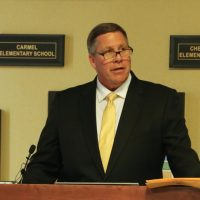 Thomas Harmas speaks to the Carmel school board after the announcement about his new role as principal at Carmel High School. (Photo by Ann Marie Shambaugh)