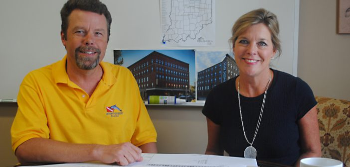 Jeff Ryan and Ronda Shrewsbury Weybright examine plans for Real America's SouthPointe Village Apartments proposed for downtown Fishers. (Photo by Anna Skinner)