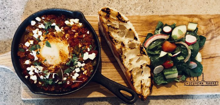 The Rail Epicurean's Shakshuka is a Middle Eastern dish paired with a grilled baguette and fresh, locally sourced spinach salad. (Photo by Anna Skinner)