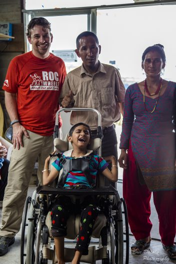 Eric Donoho, left, and Center for Disabled Children Assistance founder Dendi Sherpa pause with Bishnu and his mother. (Submitted photo)