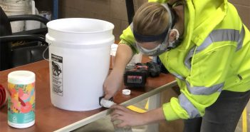 Carmel Street Dept. employee Talia Ariens fills a bottle of hand sanitizer. (Submitted photo)