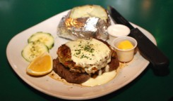 Murphy's Pubhouse Filet Mignon, Oscar Style, served with a baked potato, butter and sour cream on the side.